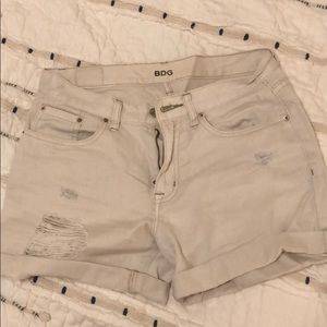 Urban Outfitters BDG beige distressed denim shorts